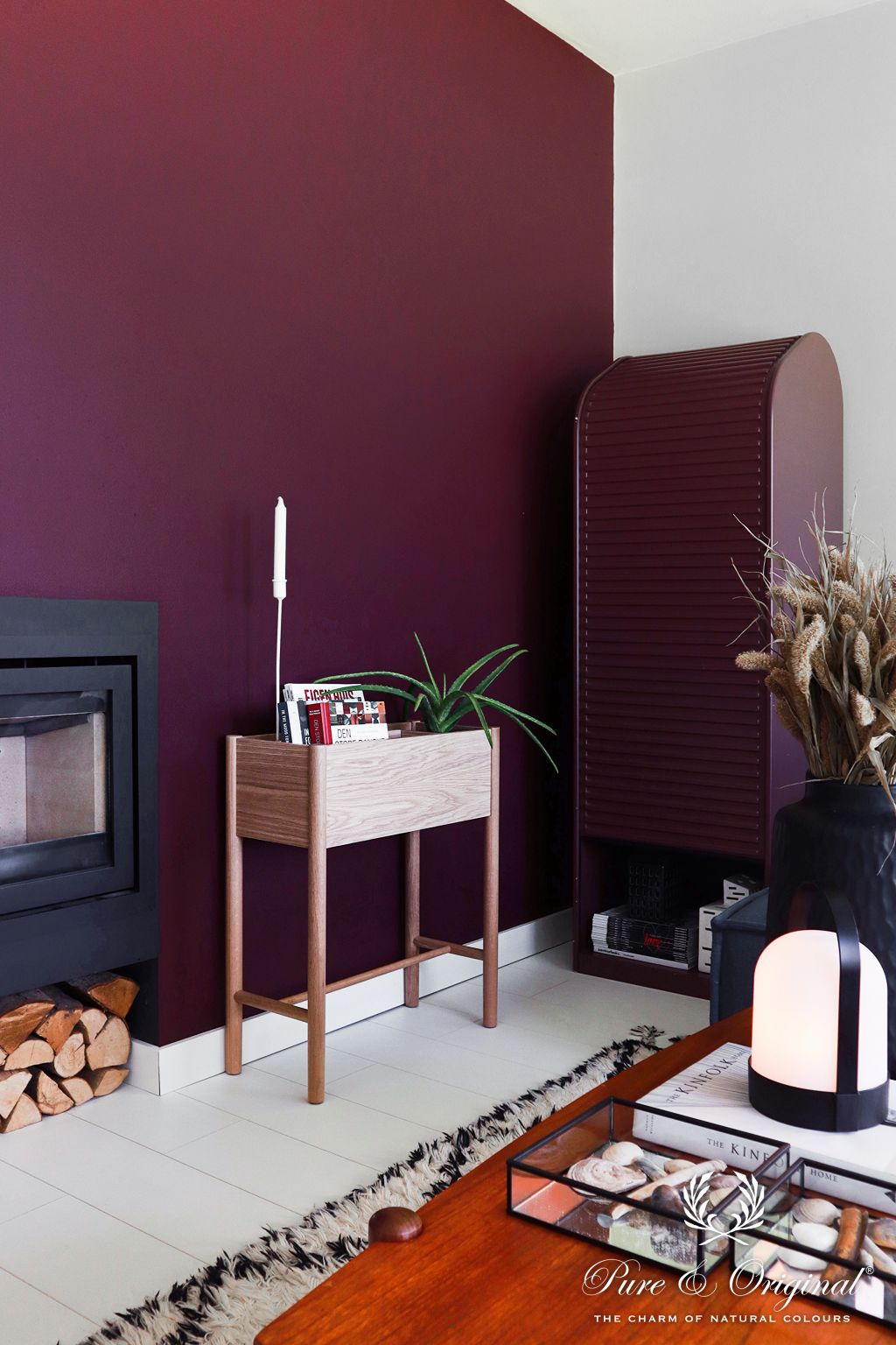 Purple wall living room magazine stand