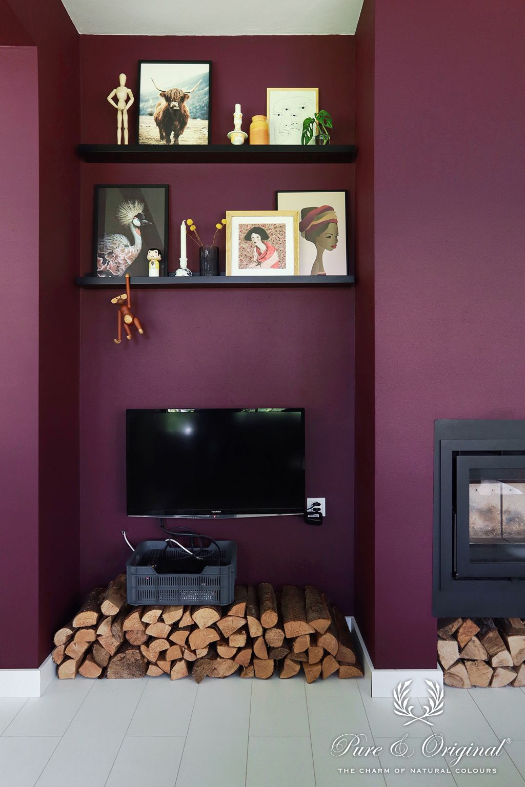 Plum wall after makeover with fireplace and art wall