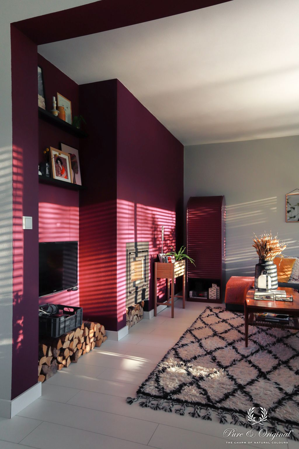 Plum dark purple in the living room with sunlight, fireplace and rug