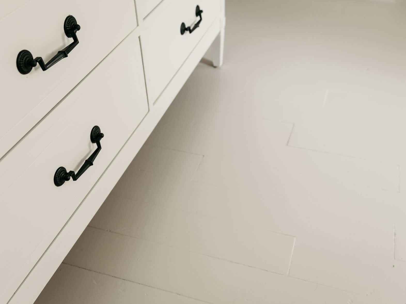 Pure & Original Carazzo floor paint in Chalk White on the floor in the kitchen
