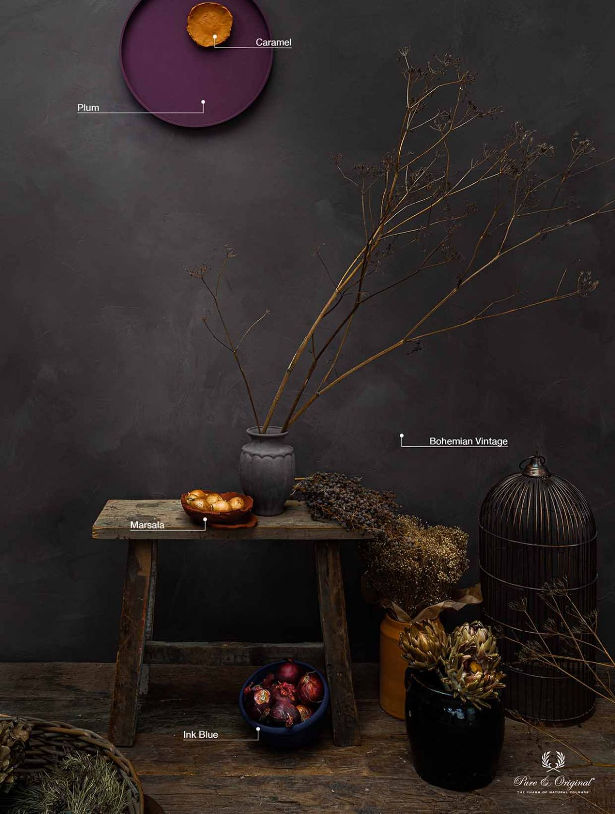Country home interior with lime paint in dark tints, dried flowers and pots