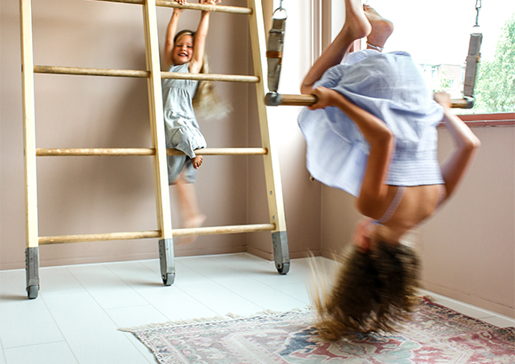 Children play area with pink room, gymnastics and rug