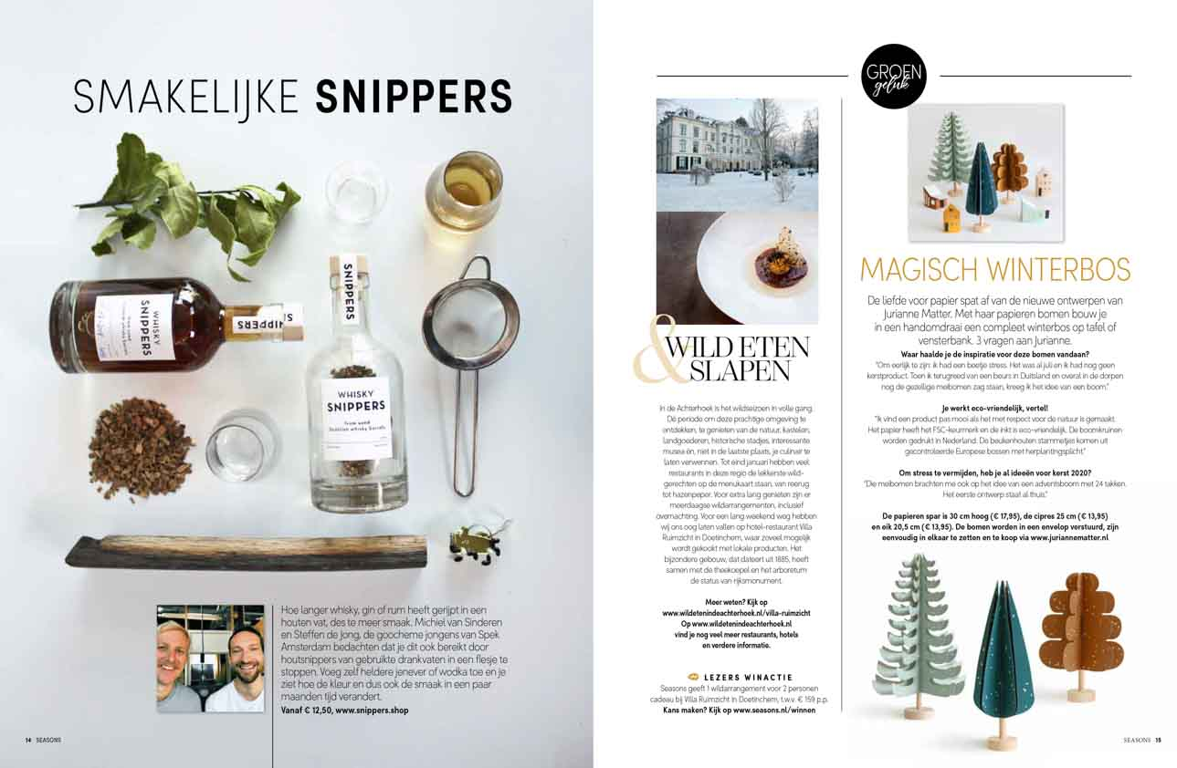 Article with Christmas decoration and gifts including whiskey snippers
