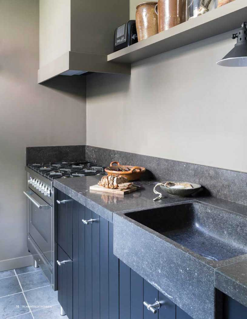 Kitchen in brown and grey shades. Paint, wood and stone