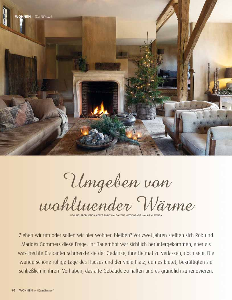 Article with picture of living room with tan walls, a fire place, and a Christmas tree
