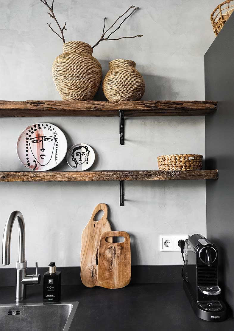 Marrakech Walls in the colour Evening Shadow in a black kitchen with wooden planks