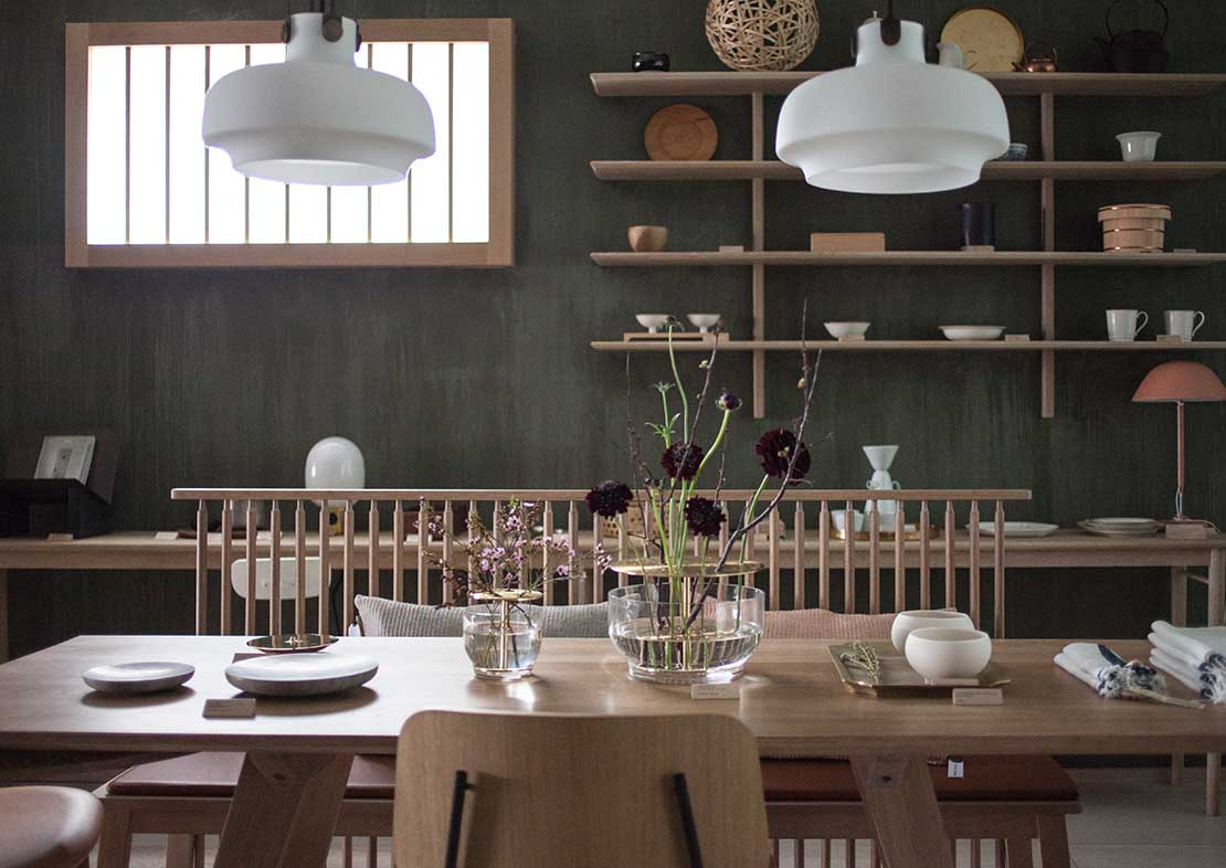 Dining table with wooden table, chairs and green lime paint on the walls