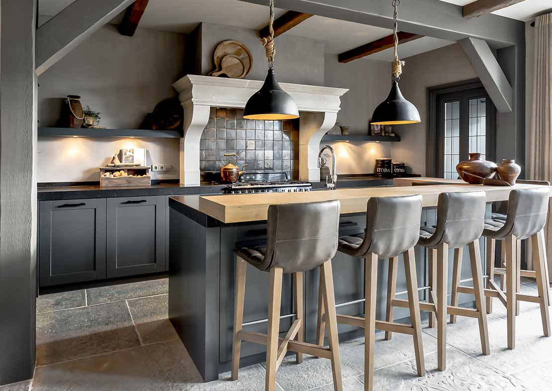 Pure & Original beige lime paint gray country estate living kitchen with wooden top bar stools and large stove